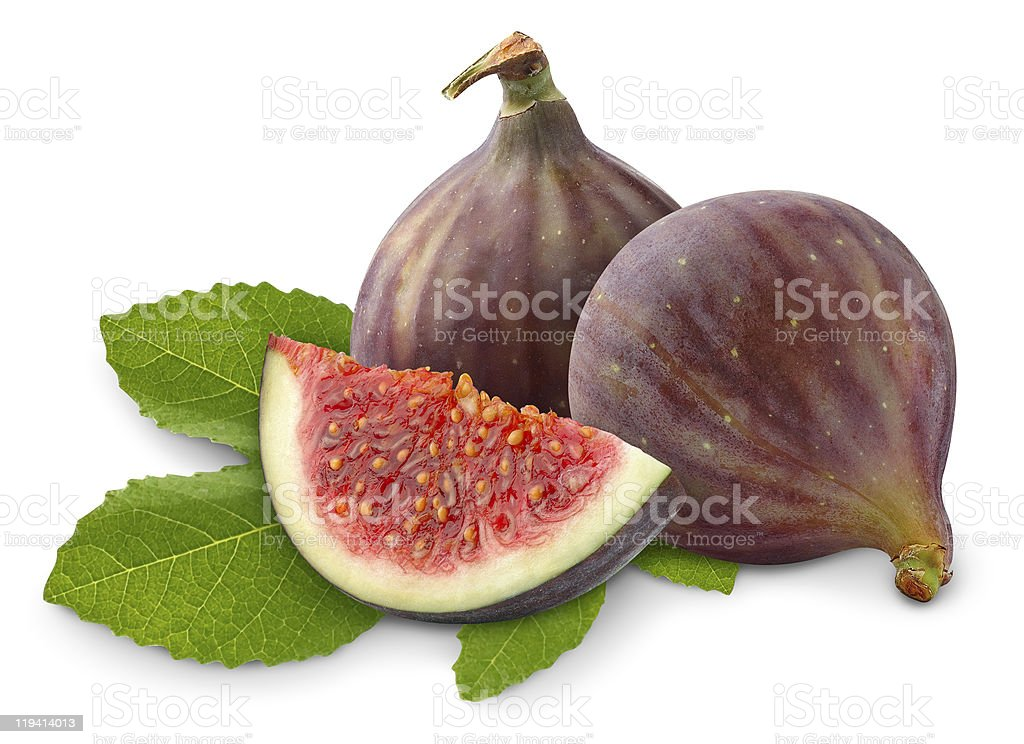 Fresh figs laying on green leaves stock photo