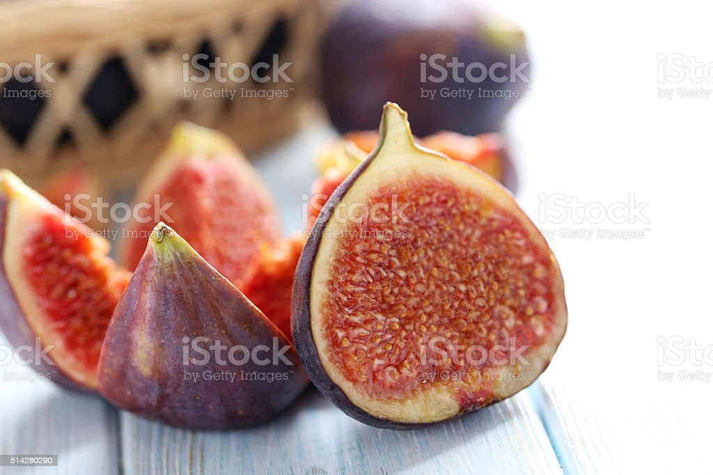 Fresh figs on a blue wooden table stock photo