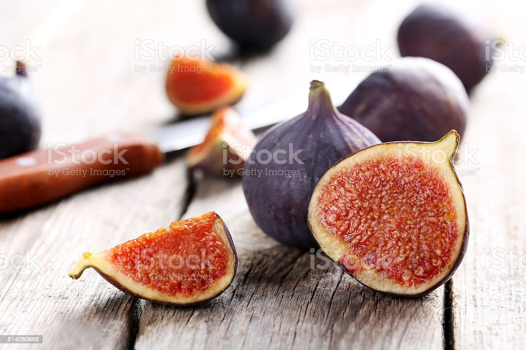 Fresh figs on a grey wooden table stock photo