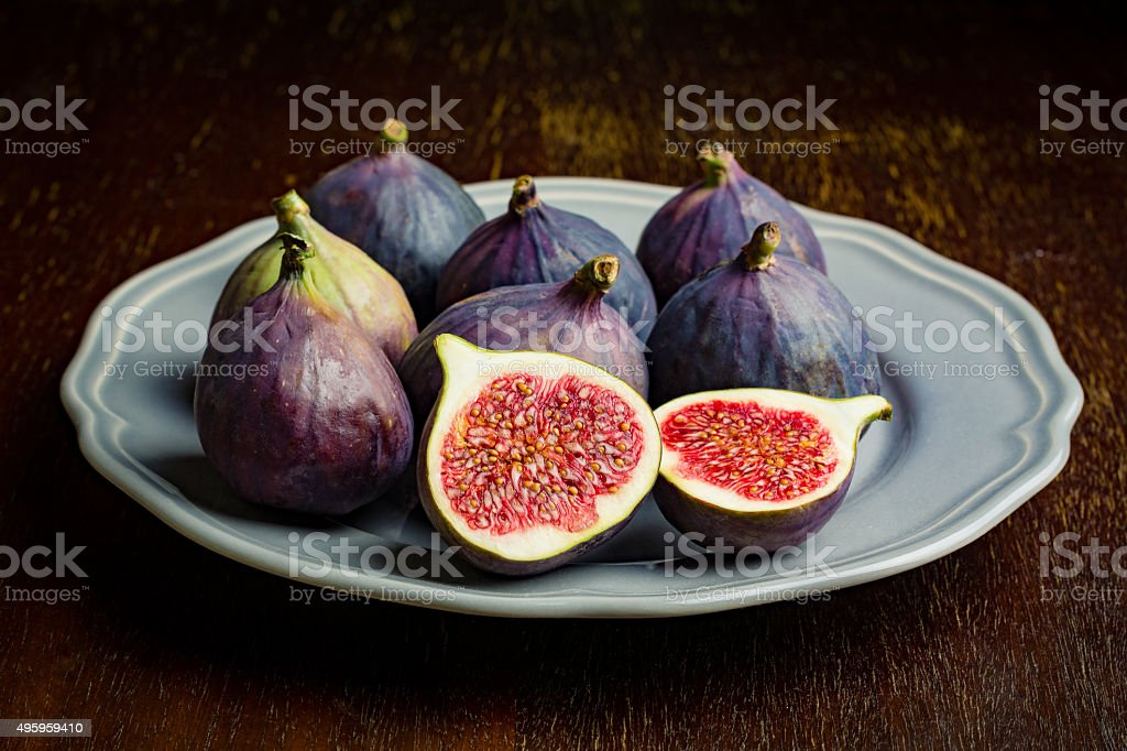 Fresh figs on plate stock photo