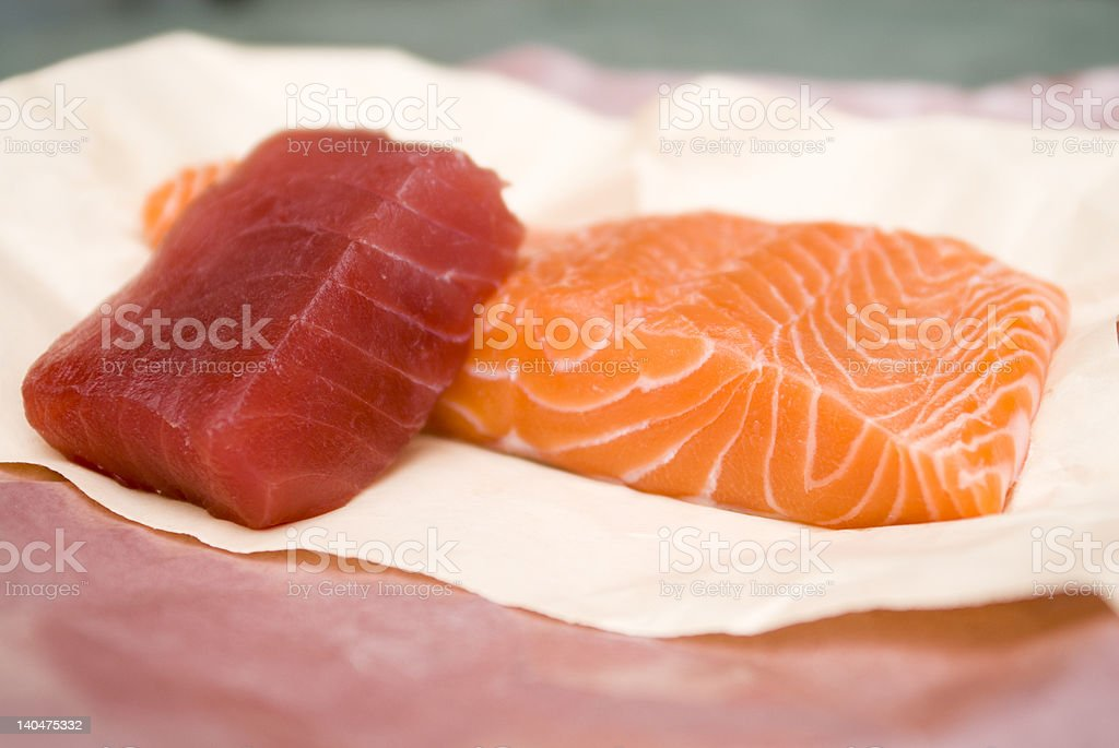 Fresh filets of Pacific salmon and Ahi tuna royalty-free stock photo
