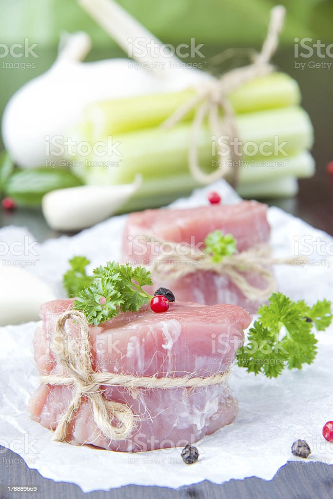 Fresh fillet of raw meat with spices and herbs stock photo