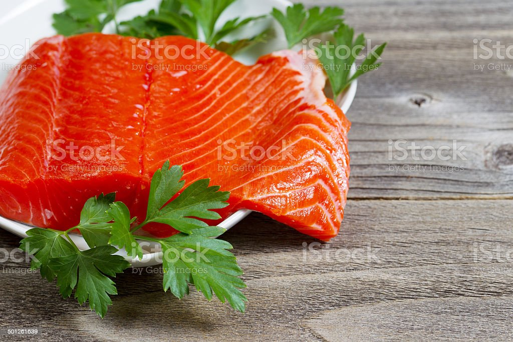 Fresh Fillet of Sockeye Salmon with parsley stock photo