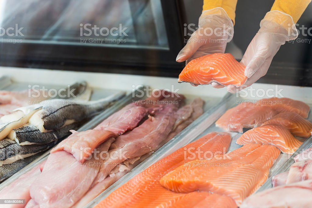 Fresh fish fillets for sale in seafood store stock photo