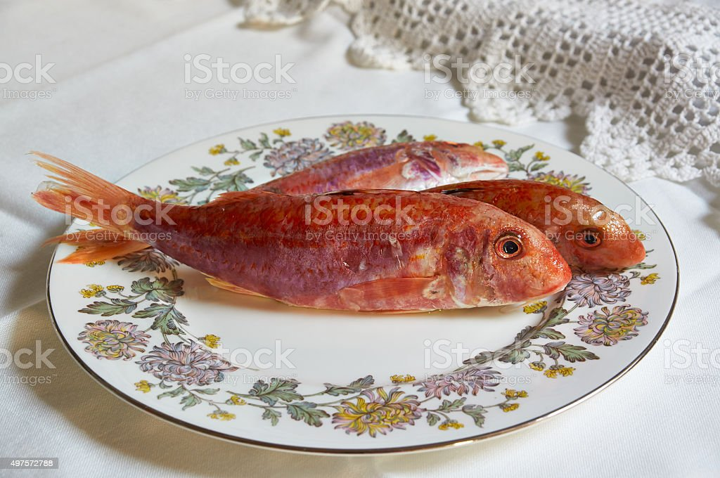 Fresh fish of Mediterranean cooking  on tables stock photo