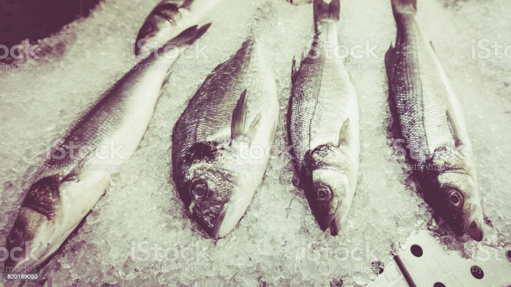 fresh fish on ice. Vintage Retro Filter stock photo