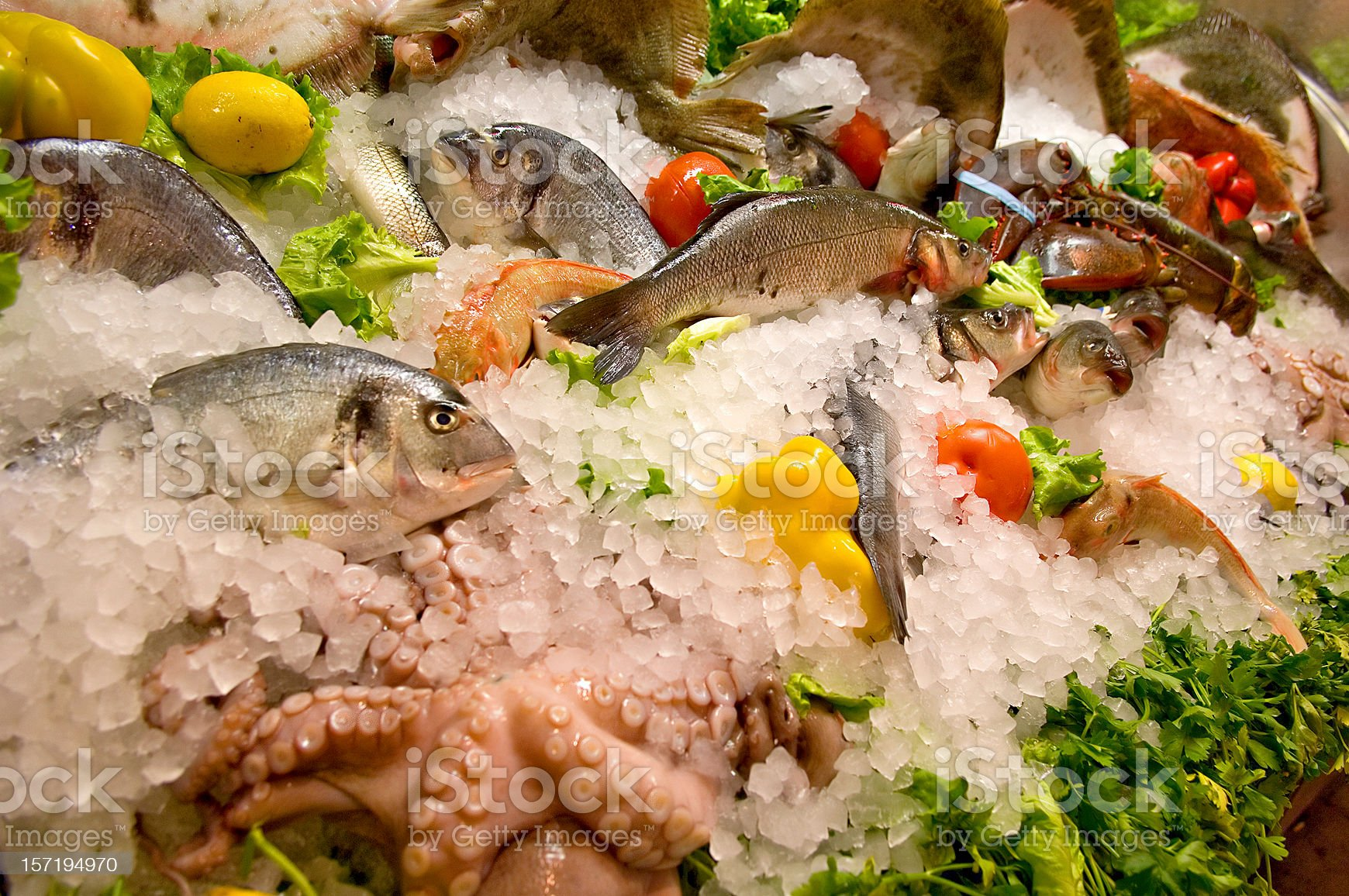 Fresh fish on packed ice with produce royalty-free stock photo