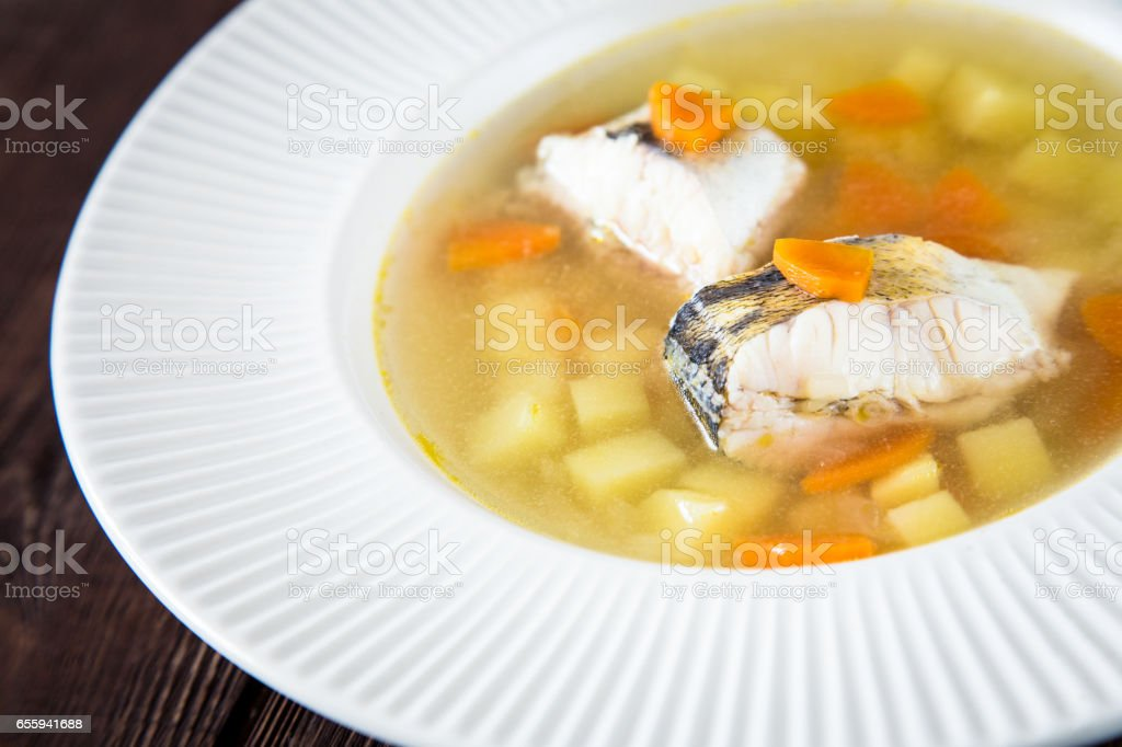 fresh fish soup with pike perch and vegetables stock photo