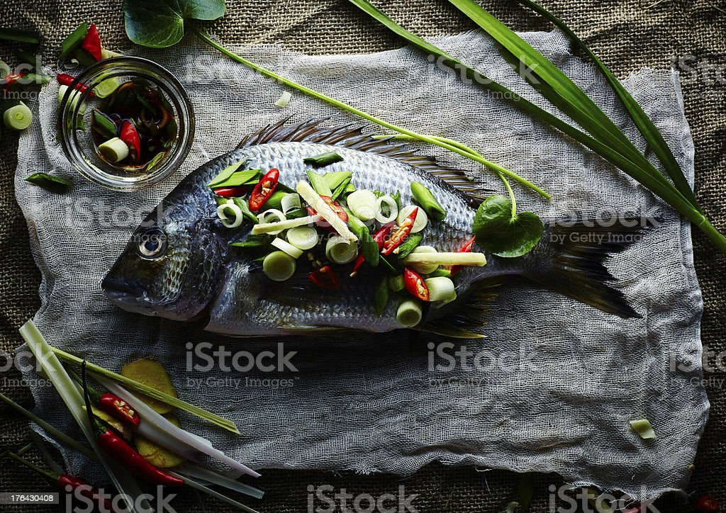 fresh fish with asian spices stock photo