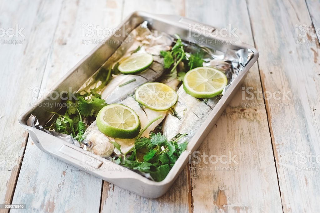 Fresh fish with lemon and Herbs recipe stock photo