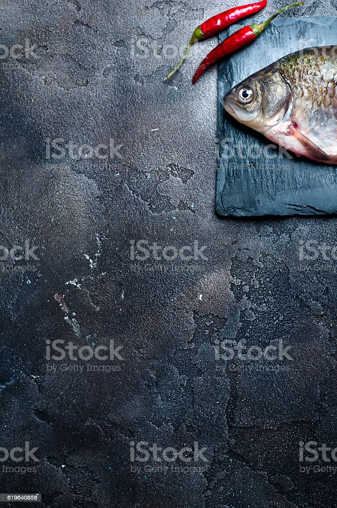 Fresh fish with spices on a stone board stock photo