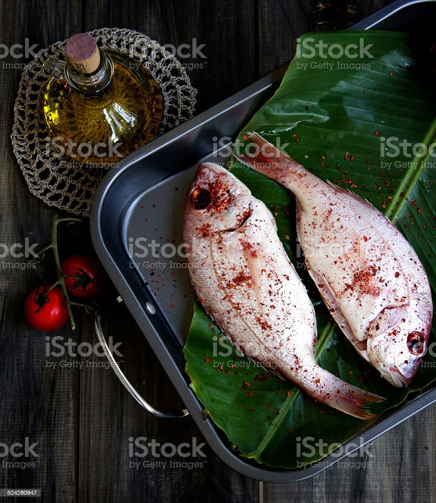 Fresh fish with vegetables stock photo