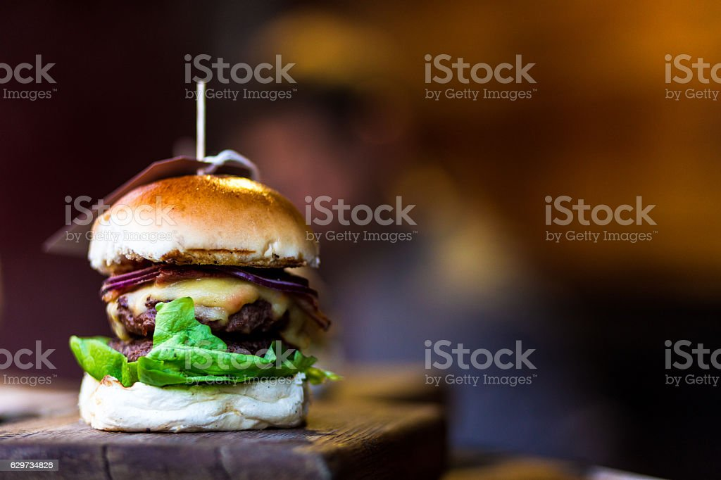 Fresh flame grilled burger with chef defocused in background stock photo