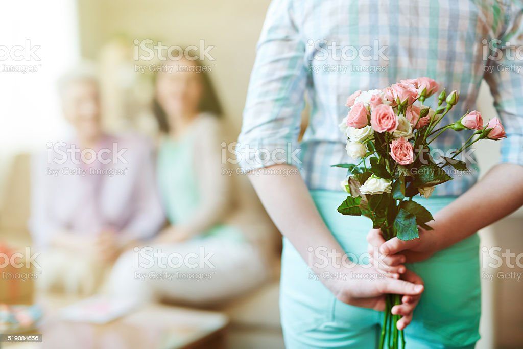 Fresh flowers in hands stock photo