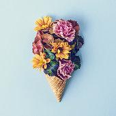Fresh flowers in ice cream cone still life
