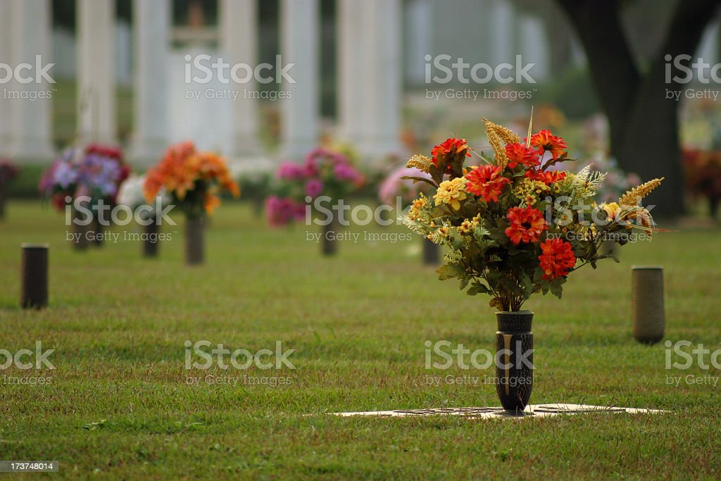 Fresh flowers in vases at a cemetery stock photo