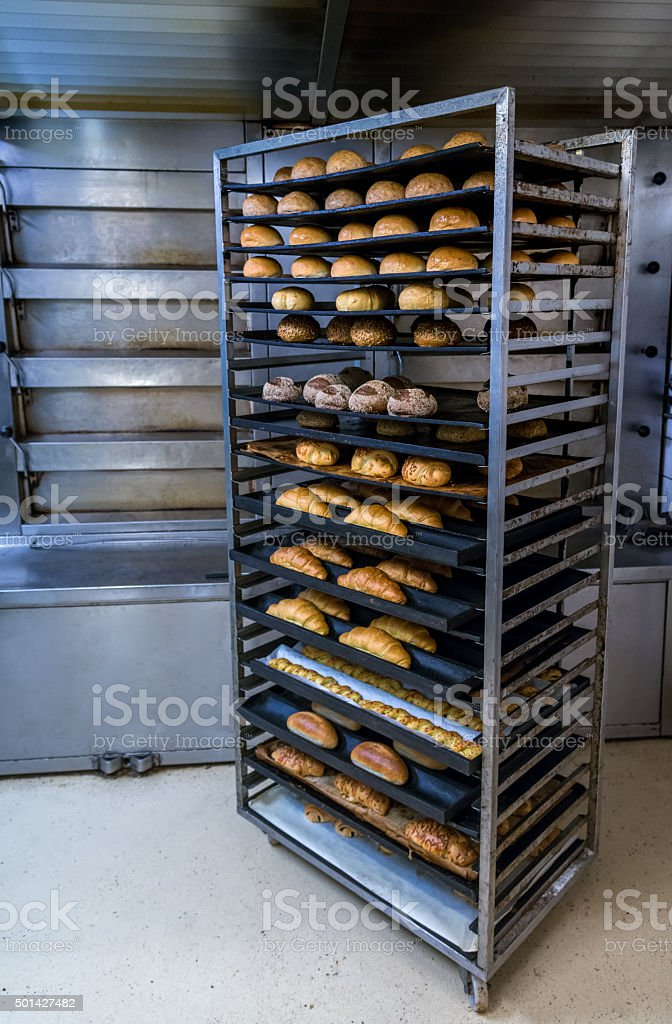Fresh French Bread in a Bakery in cooling rack stock photo