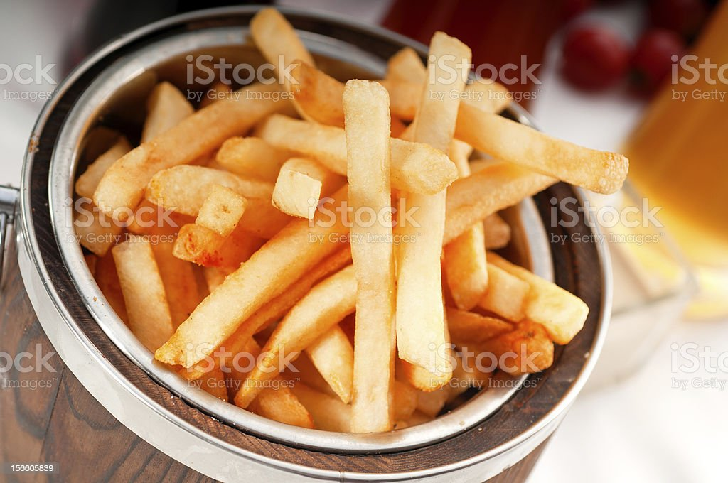 fresh french fries on a bucket royalty-free stock photo
