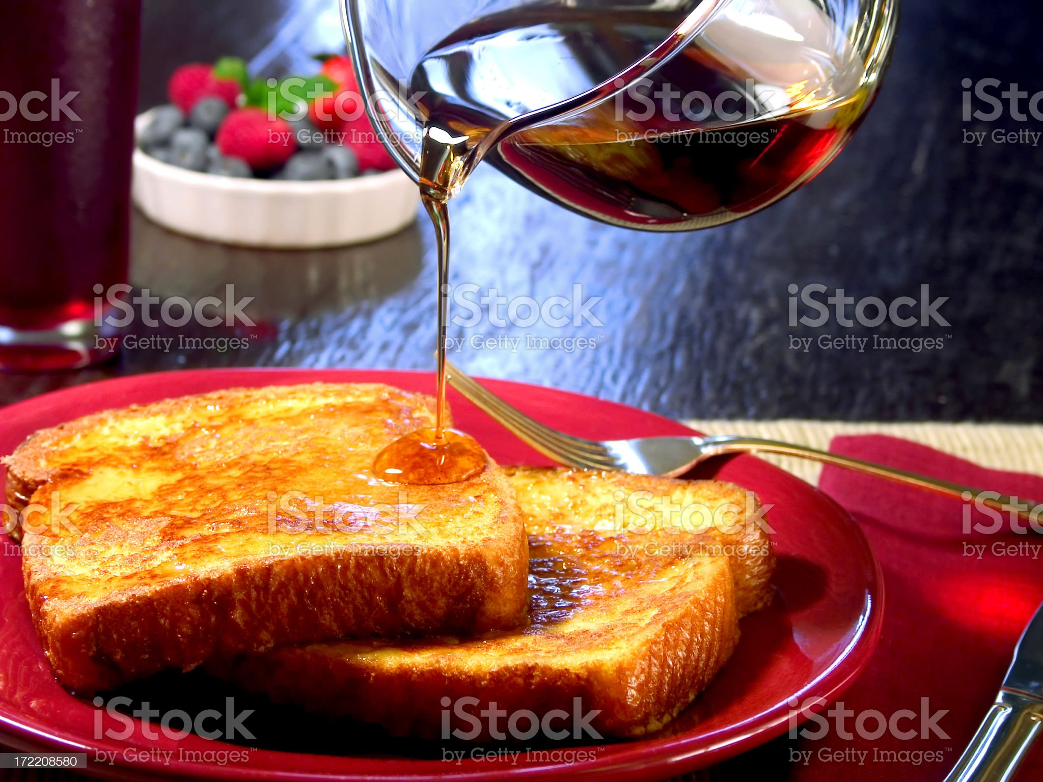 Fresh French toasts with pouring syrup royalty-free stock photo