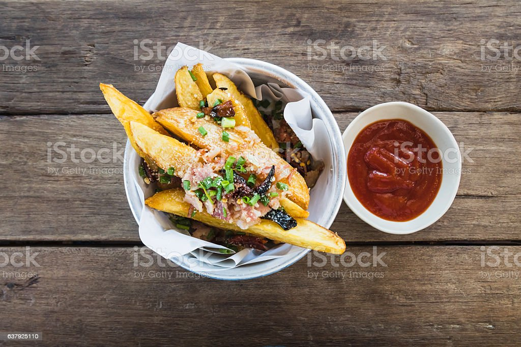 fresh fried french fries with ketchup on wood table stock photo