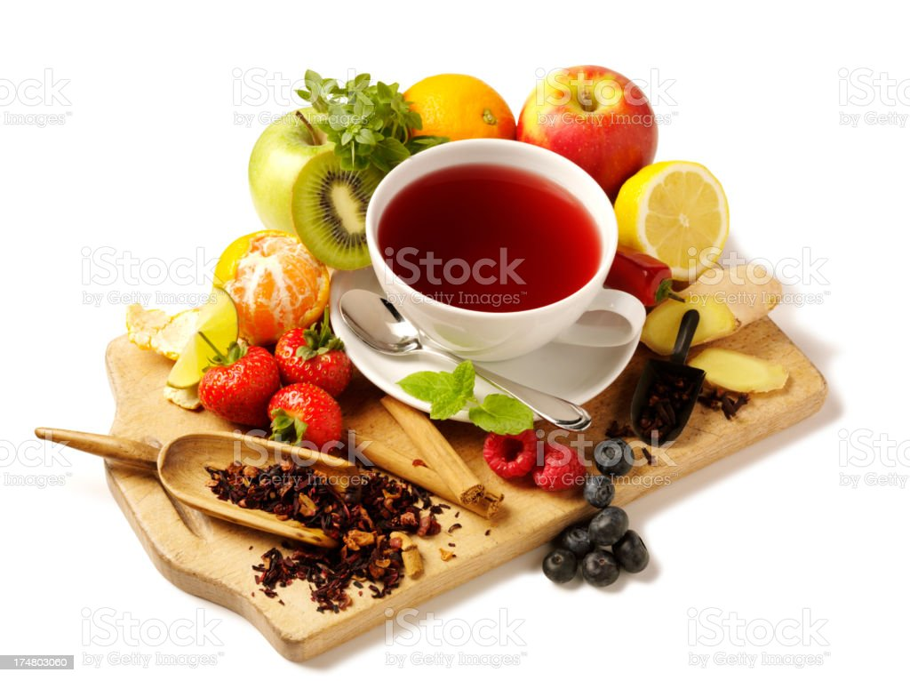 Fresh Fruit and Tea Cup on a Chopping Board royalty-free stock photo