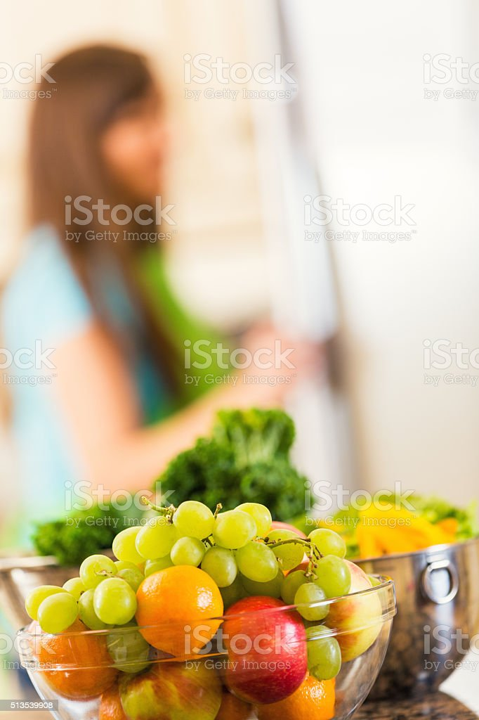 Fresh fruit and vegetables on kitchen counter stock photo