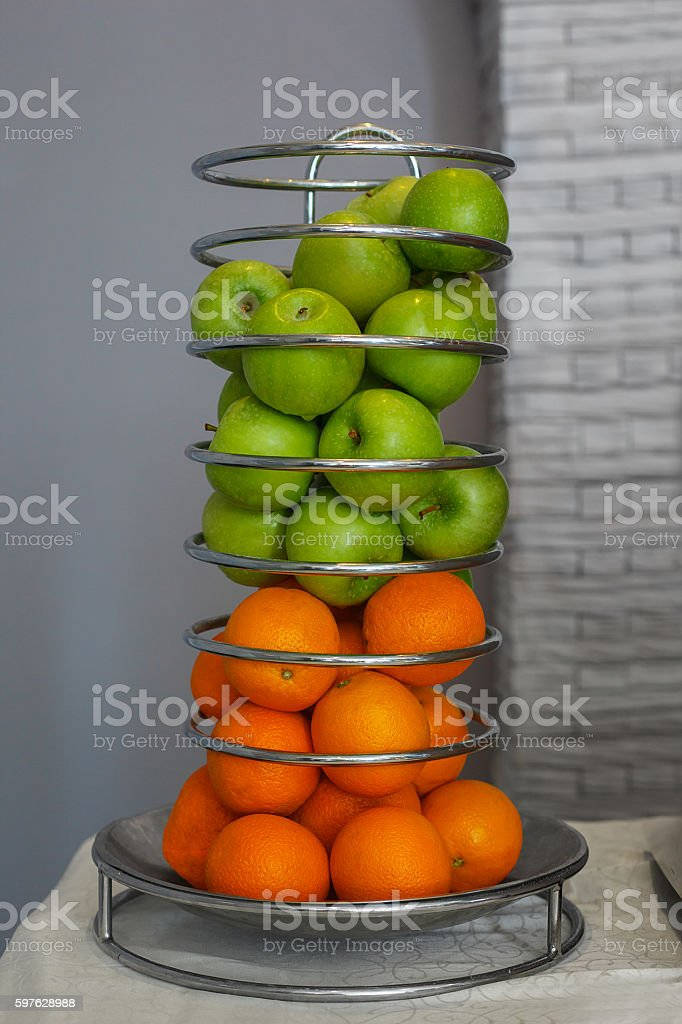 Fresh fruit apples and oranges on the buffet stock photo