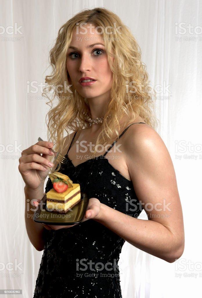 Fresh fruit cake presented by blonde girl royalty-free stock photo