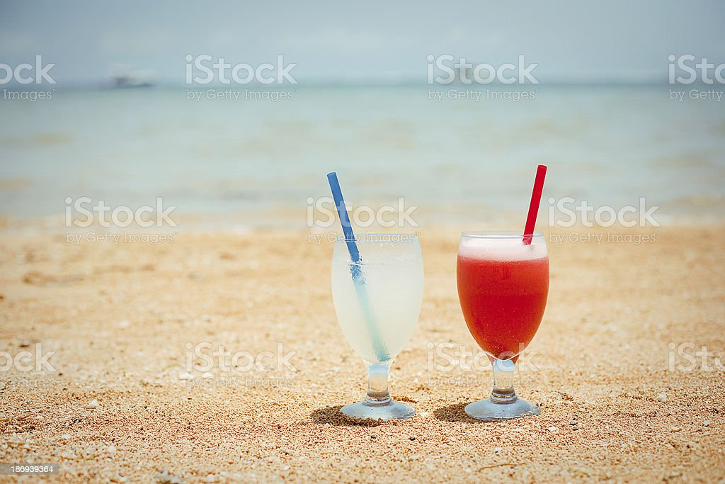 Fresh fruit cocktail on beach royalty-free stock photo