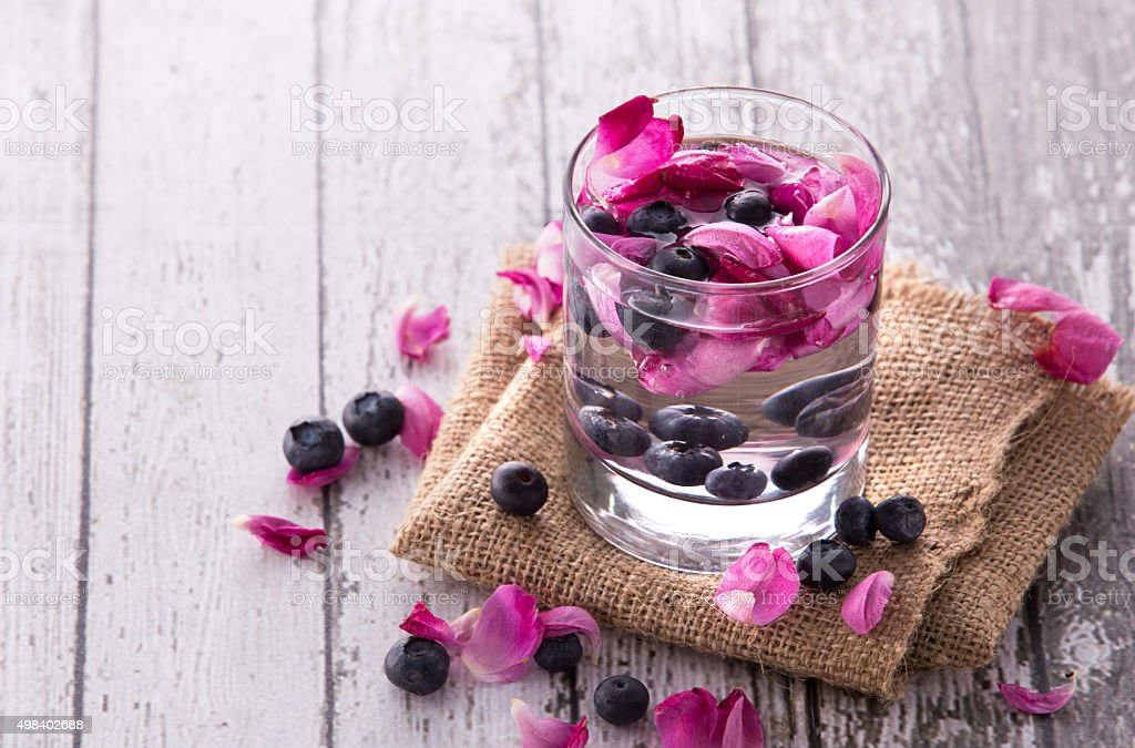fresh fruit Flavored infused water mix of blueberry and rose stock photo