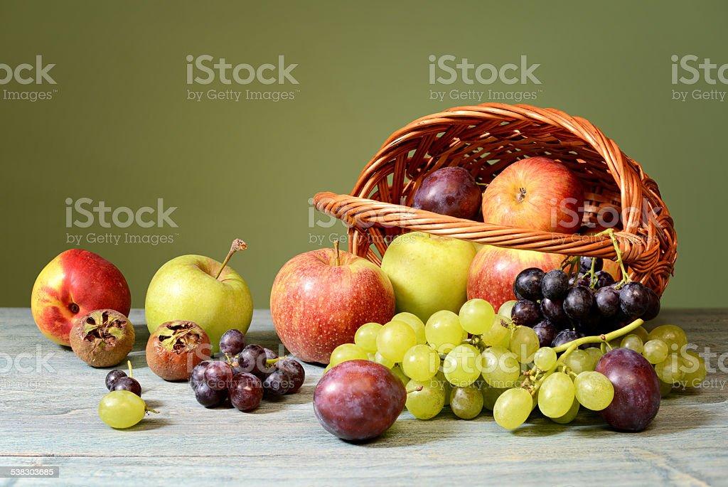 Fresh fruit in a wicker basket stock photo