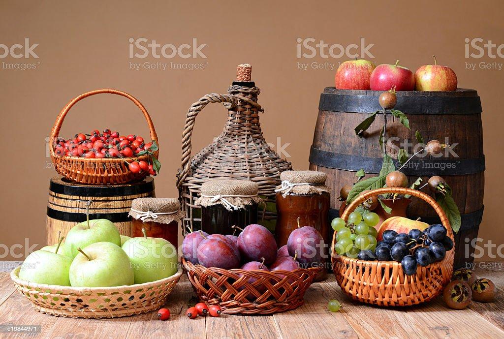 Fresh fruit, jam and wooden barrel stock photo