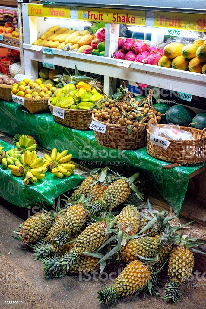 Fresh fruit market in Asia at night. stock photo
