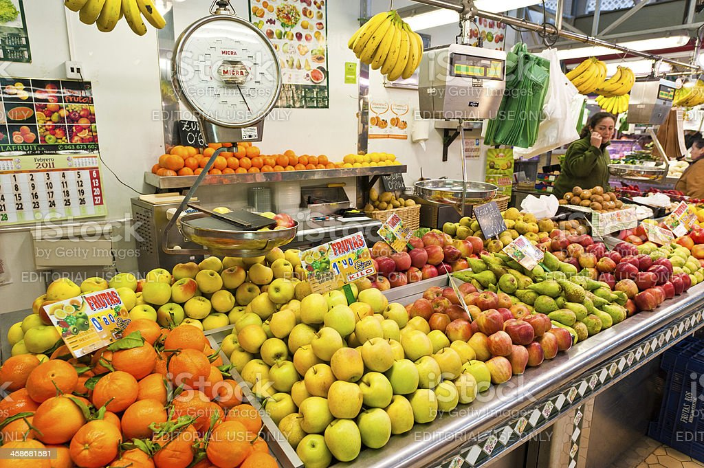 Fresh fruit oranges apples colourful market stall Valencia Spain royalty-free stock photo