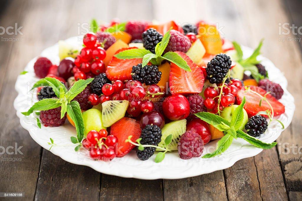Fresh fruit salad on the plate stock photo