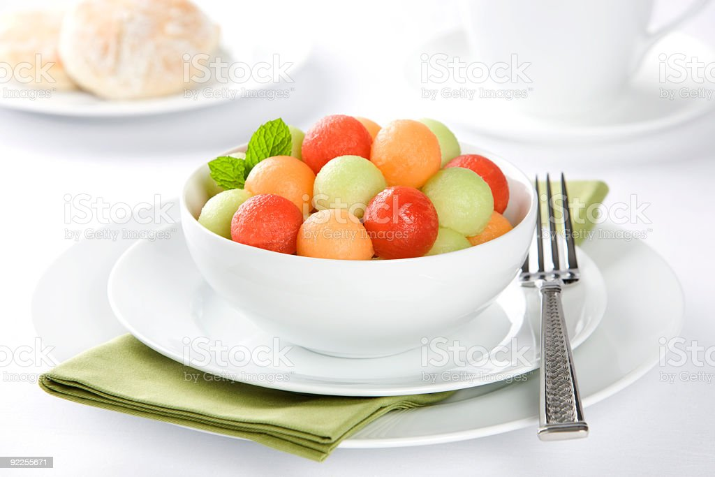 Fresh fruit watermelon, canteloupe and honeydew with biscuit royalty-free stock photo