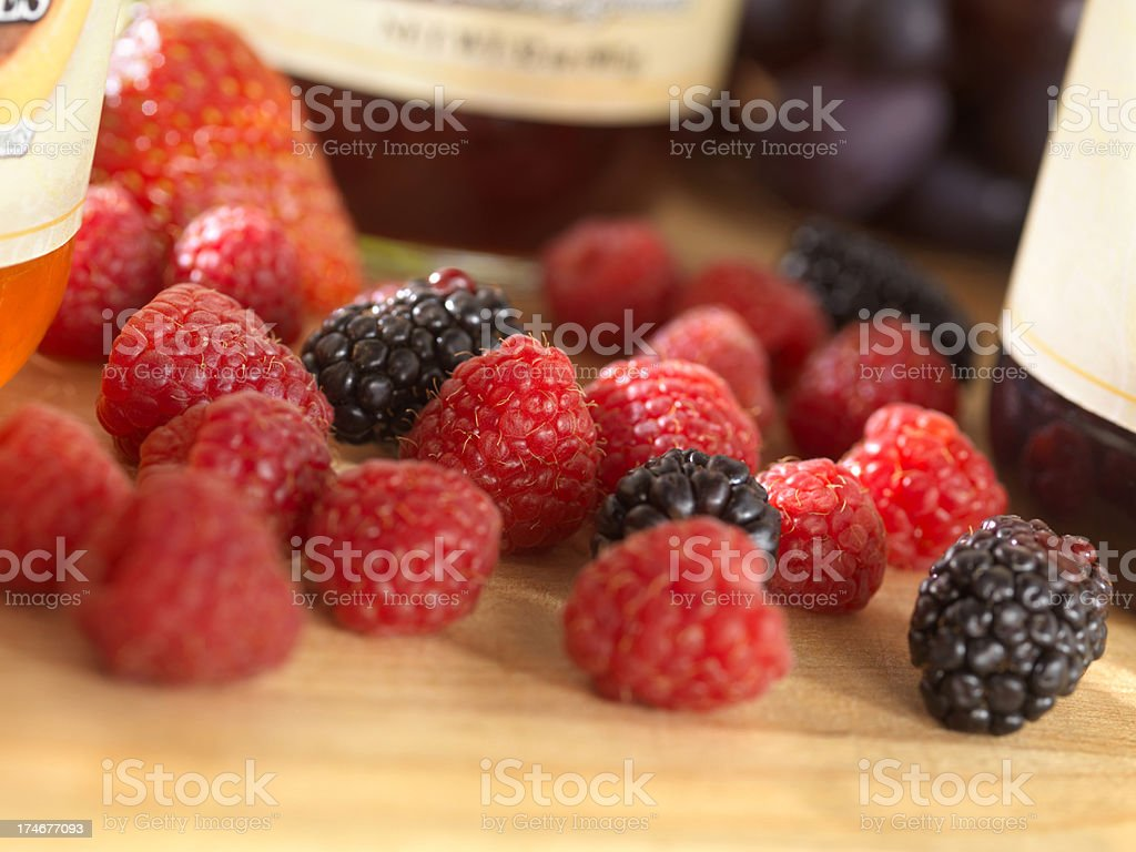 Fresh Fruit with Jars of Jam royalty-free stock photo