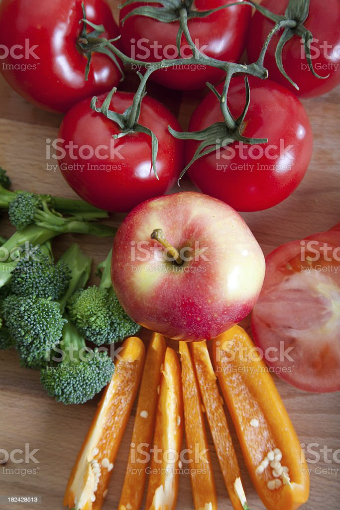 Fresh Fruits and Vegetables Aligned on a Kitchen Counter royalty-free stock photo