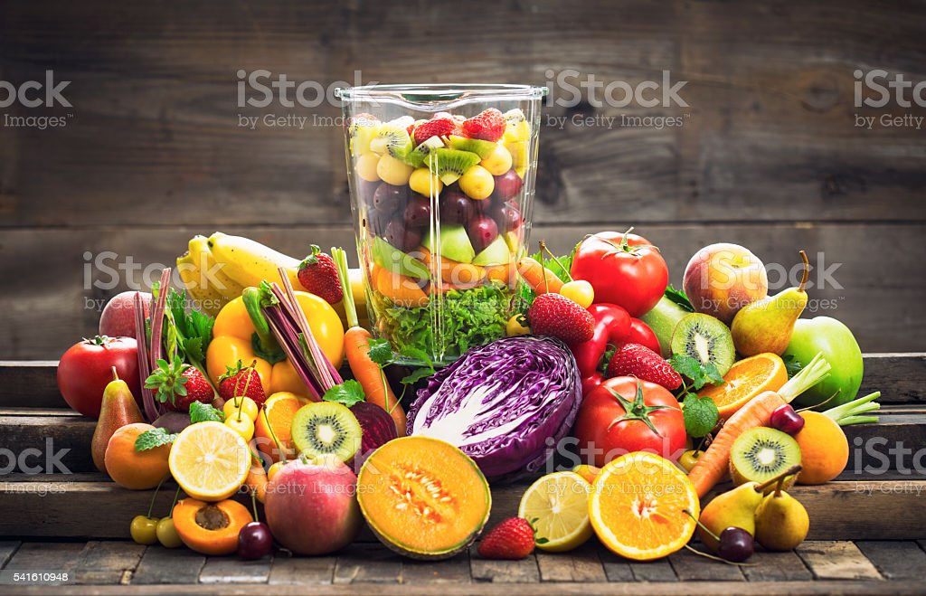 Fresh fruits and vegetables in the blender stock photo