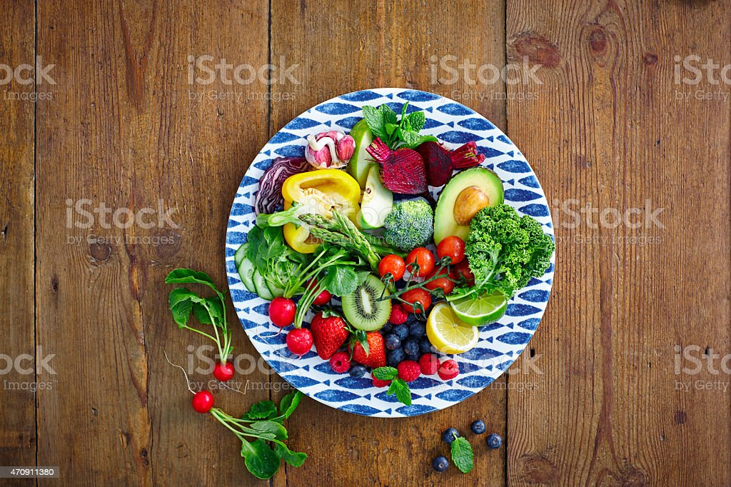 Fresh fruits and vegetables salad stock photo