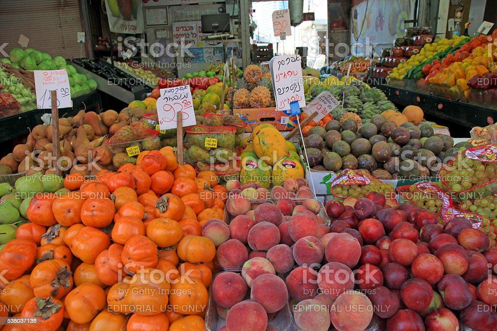 Fresh fruits in outdoor Carmel Market in Tel Aviv, Israel. stock photo