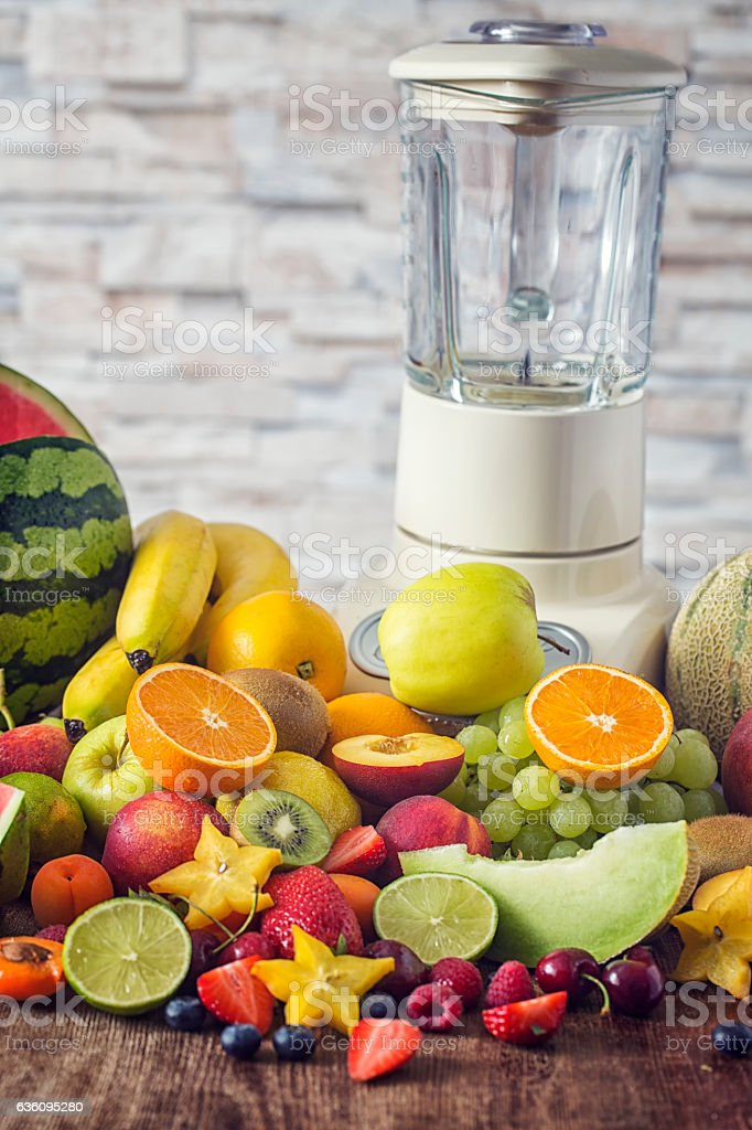 Fresh Fruits on Kitchen Table for Preparing Smoothies stock photo