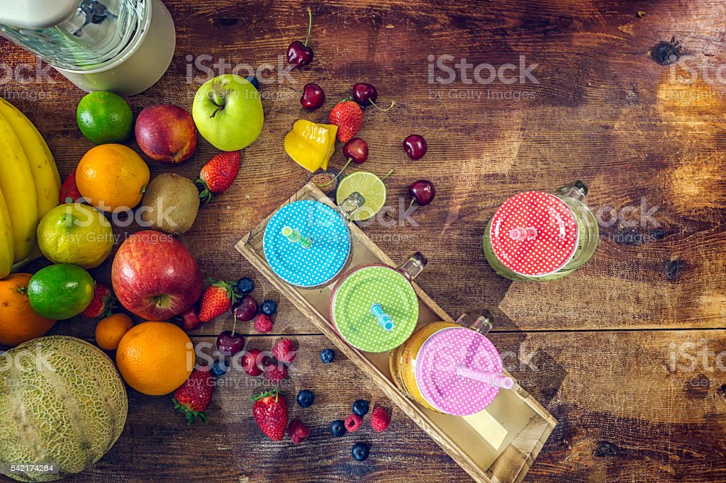 Fresh Fruits on Wooden Background for Preparing Smoothies stock photo