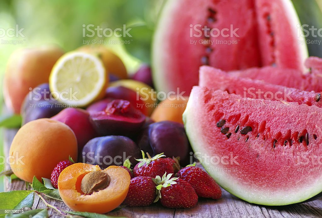 fresh fruits on wooden table stock photo