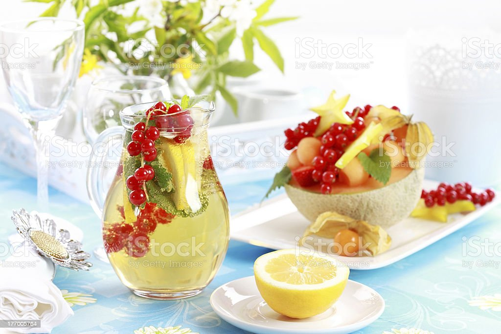 Fresh fruits served in melon bowl royalty-free stock photo