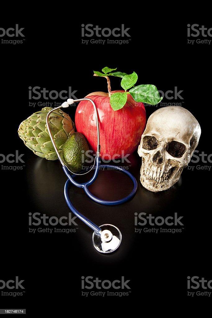 Fresh Fruits, Vegetables, Stethoscope and Human Skull stock photo