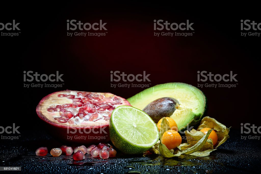 fresh fruits with waterdrops on them and knife stock photo