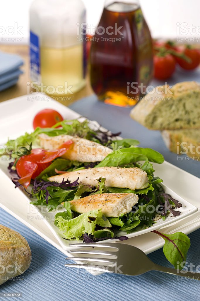fresh garden salad with threads of grilled chicken filet royalty-free stock photo