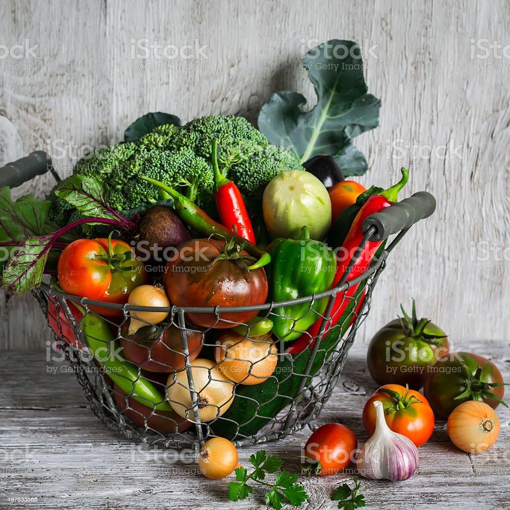 fresh garden vegetables in vintage metal basket stock photo