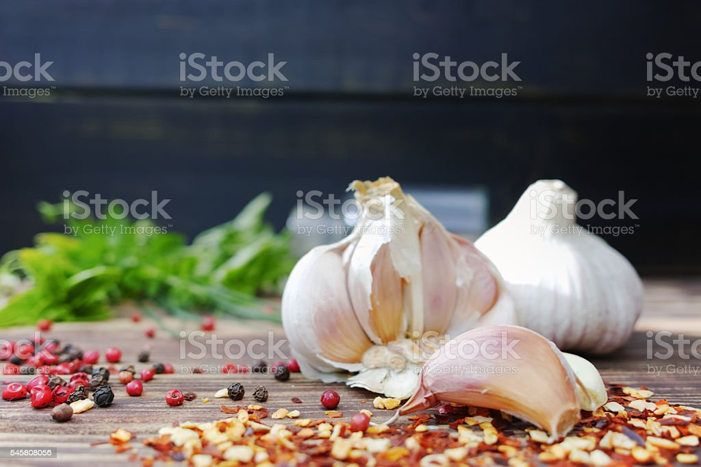 Fresh garlic and italian kitchen herbs - oregano, basil, marjora stock photo